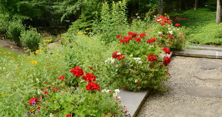 Flowers soften and provide color at front entrance