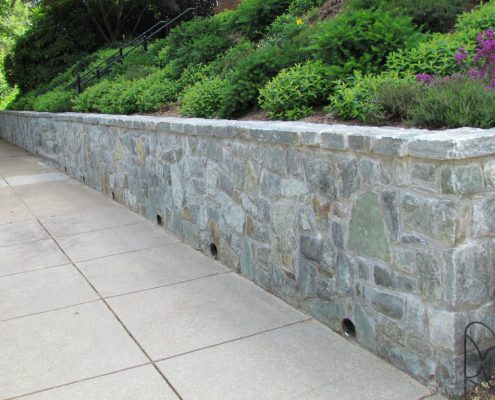 Retaining wall with weep holes for drainage