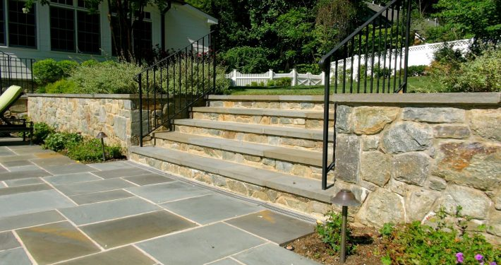 Stone steps coordinate with the stone retaining wall