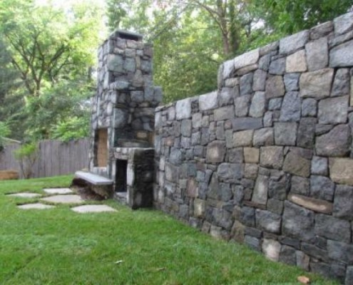 Fireplace Integrated with Stone Wall