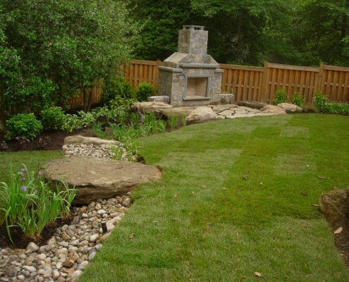 Dry stream bed leading to stone fireplace